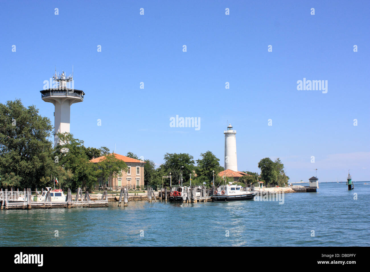 Lighthouse at Malamocco canal between Lido and Pellestrina Island - Stock Image