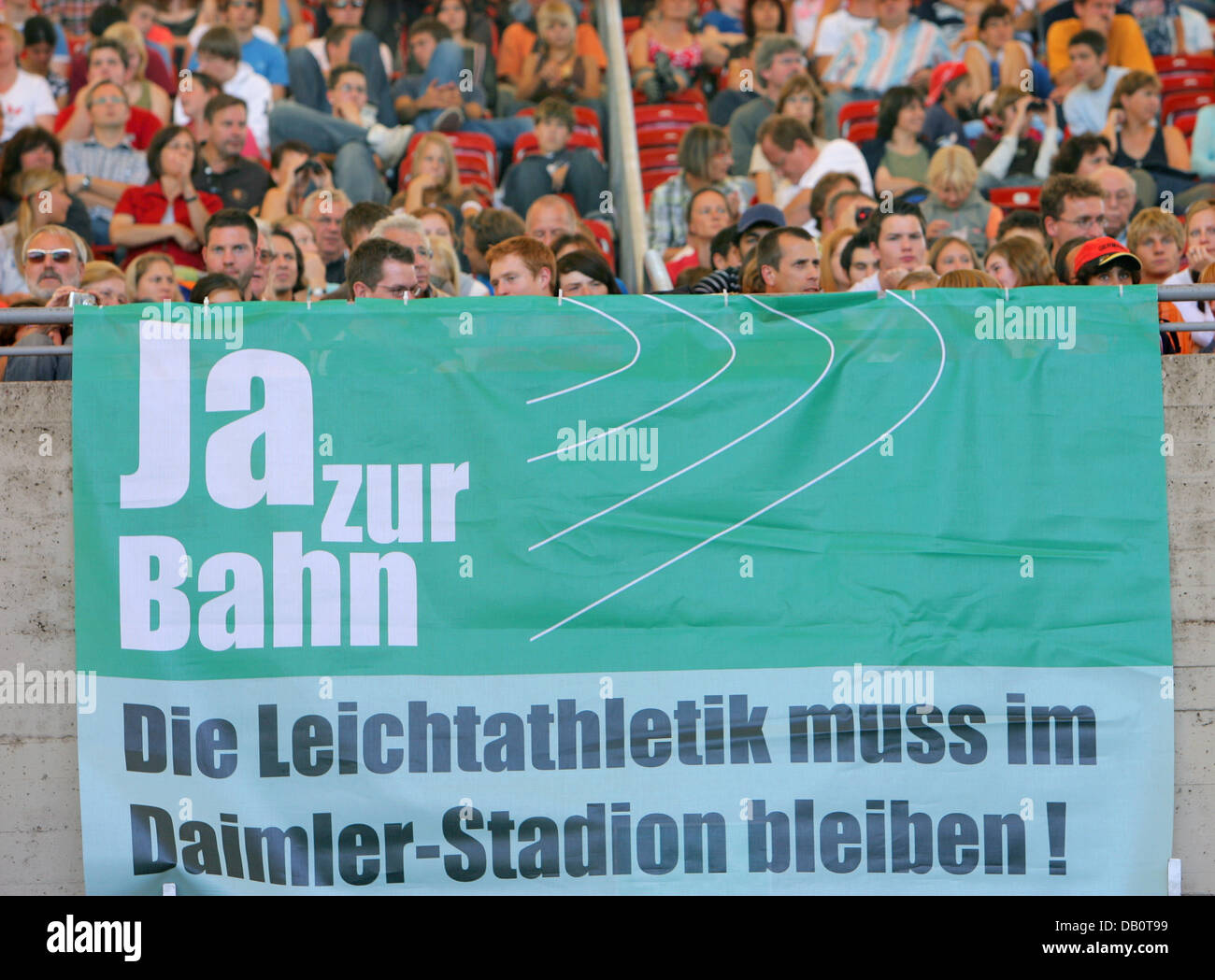 Fans say 'Yes to the track! Athletics has to remain at Gottlieb Daimler stadium!' at the IAAF World Athletics - Stock Image