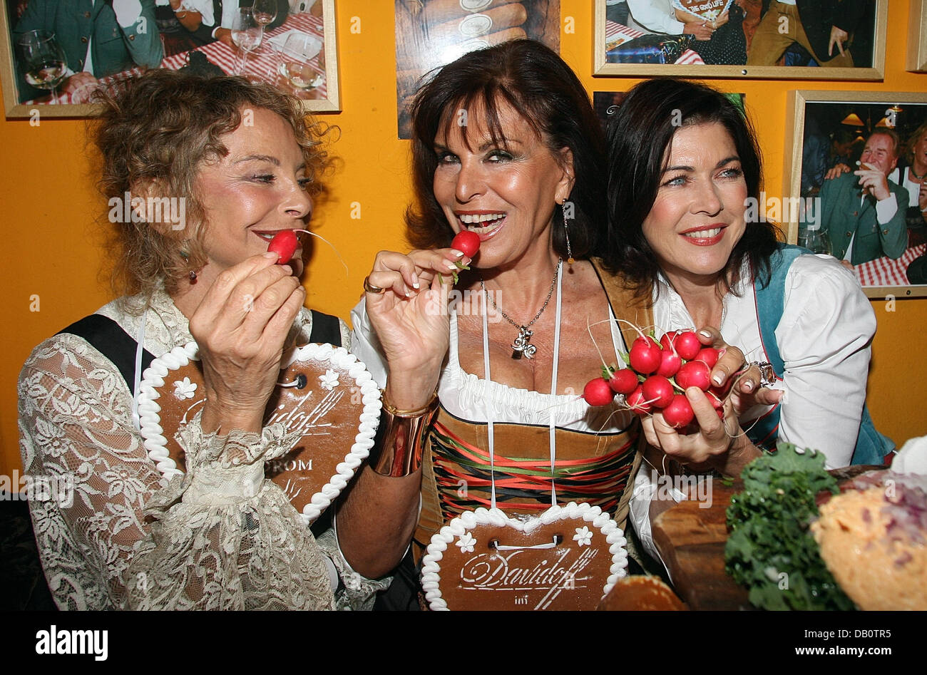 Actress Sydne Rome (L-R), astrologist Elisabeth Tessier and actress Anja Kruse show their gingerbread hearts at Stock Photo