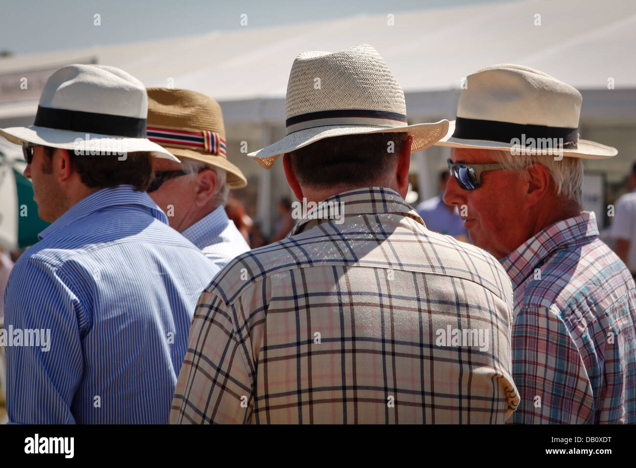 96068b332e4193 Middle aged men wearing Panama hats to keep cool during a summer heatwave -  Stock Image