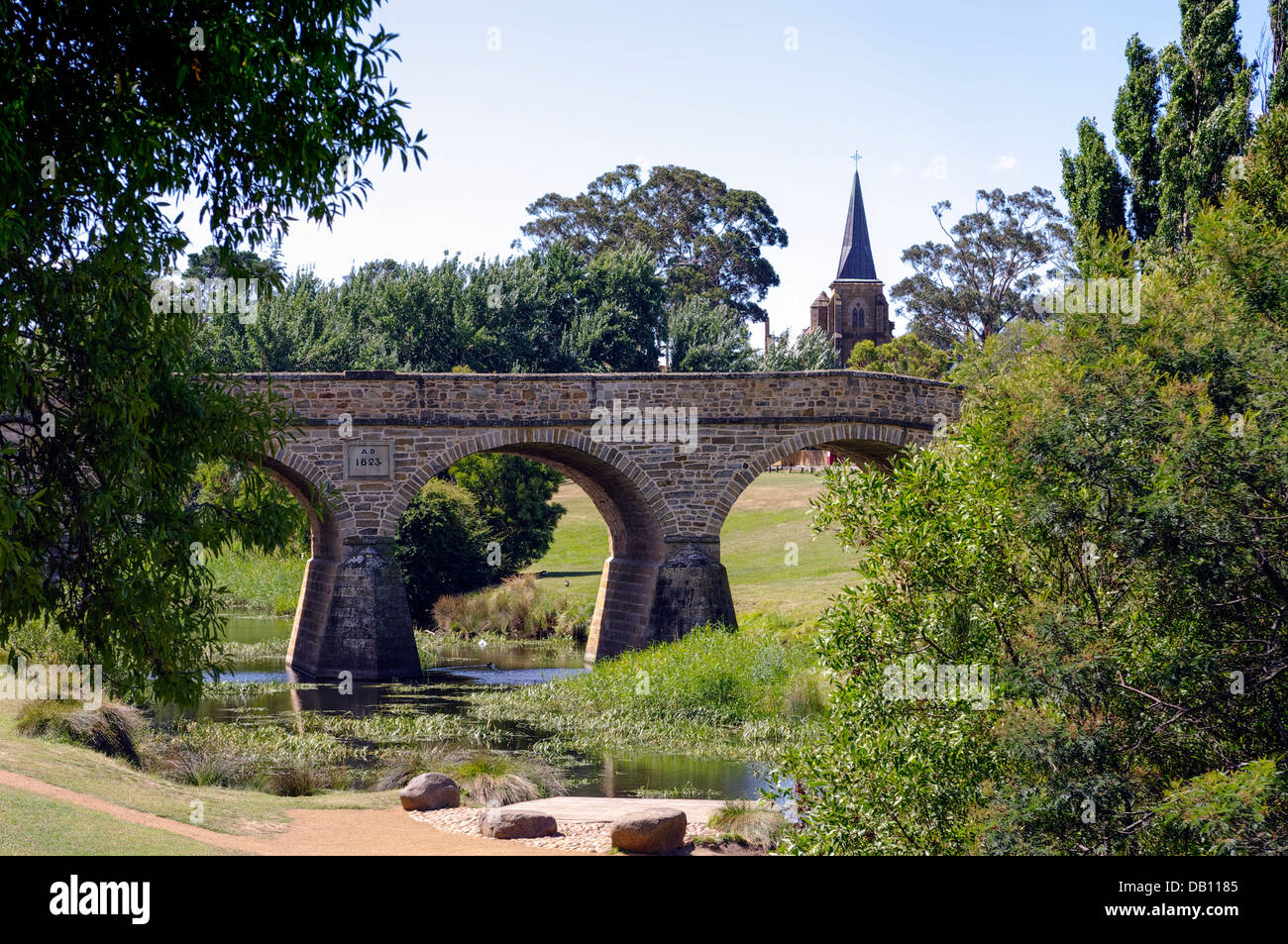Richmond church and Richmond bridge, Tasmania. This is the oldest bridge in Australia, built by convicts in 1823. - Stock Image