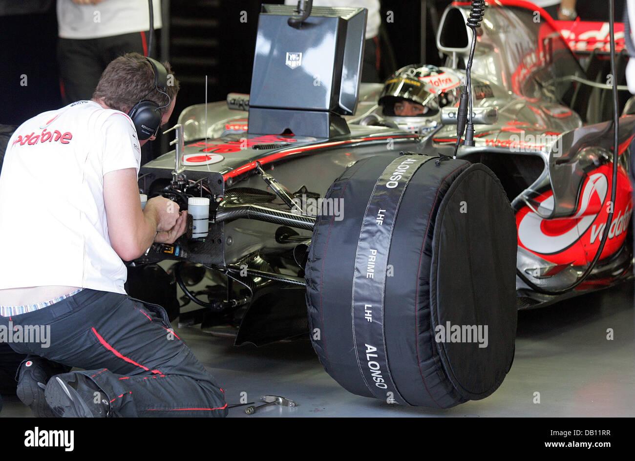 7f126db6735 A mechanic of McLaren Mercedes works on the race car of Spanish Formula One  driver Fernando