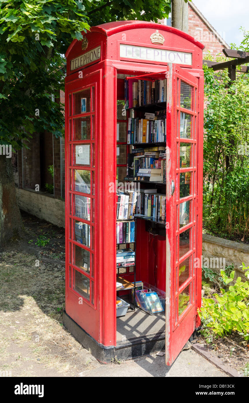 The Book Exchange honesty library in a phone box in the Worcestershire village of Belbroughton - Stock Image