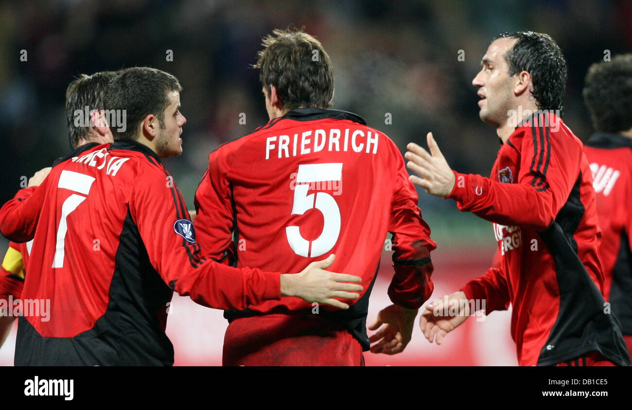 Leverkusen'S Tranquilo Barnetta (L) and Theofanis Gekas (R) cheer 1-0 scorer Manuel Friedrich (C) during the UEFA Stock Photo