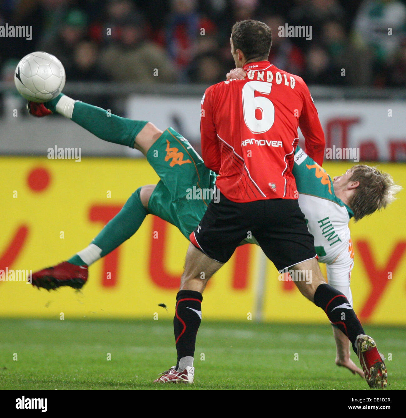 Steven Cerundolo (front) of Hanover vies for the ball with Aaron Hunt of Bremen during the Bundesliga match Hanover Stock Photo