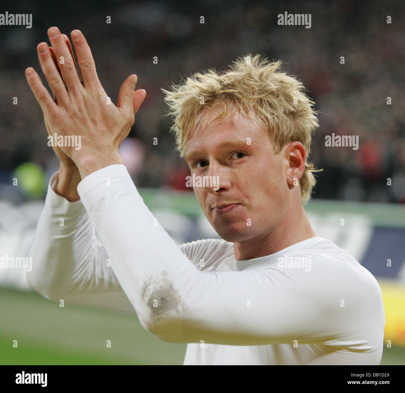 Mike Hanke of Hanover thanks the fans after the Bundesliga match Hanover 96 vs Werder Bremen at AWD-Arena stadium Stock Photo