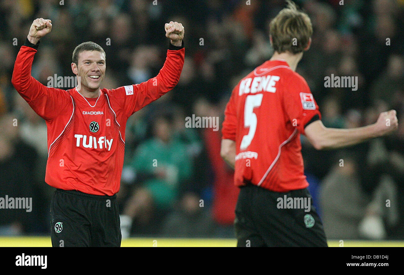 Vinicius (L) and Thomas Kleine of Hanover celebrate the victory after the Bundesliga match Hanover 96 vs Werder Stock Photo