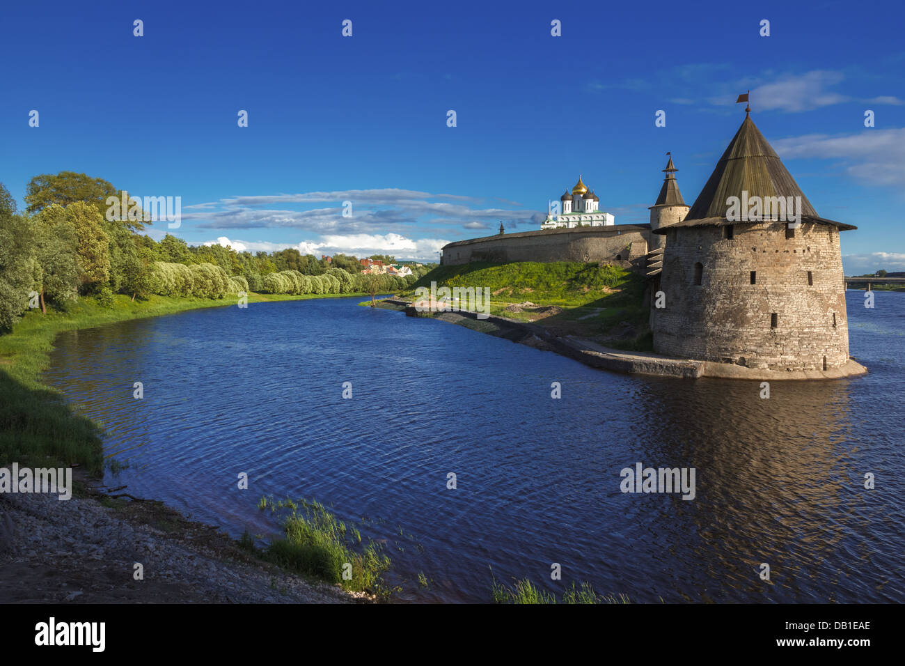 Stone tower and Pskov Kremlin fortress wall at the confluence of two rivers, Russia - Stock Image