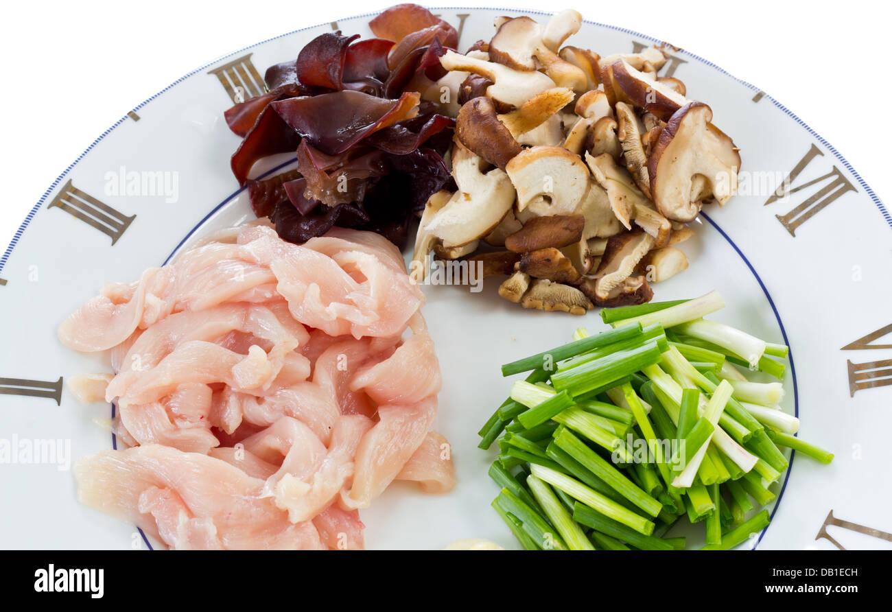 Food Ingredients including with Sliced Mushrooms, Sliced Pork and Leek. Stock Photo