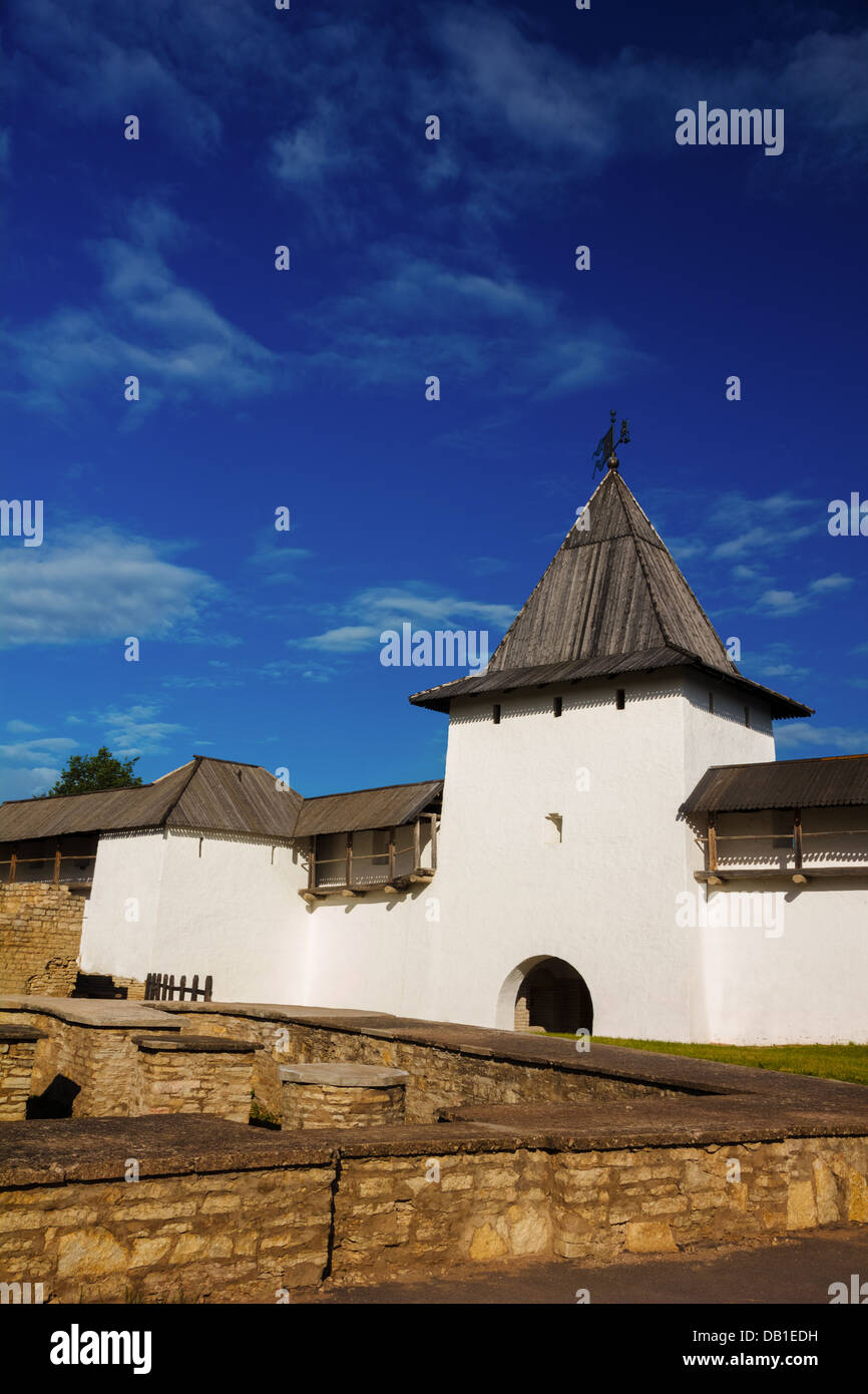 White stone tower and a fortress wall of Pskov Kremlin, Russia - Stock Image