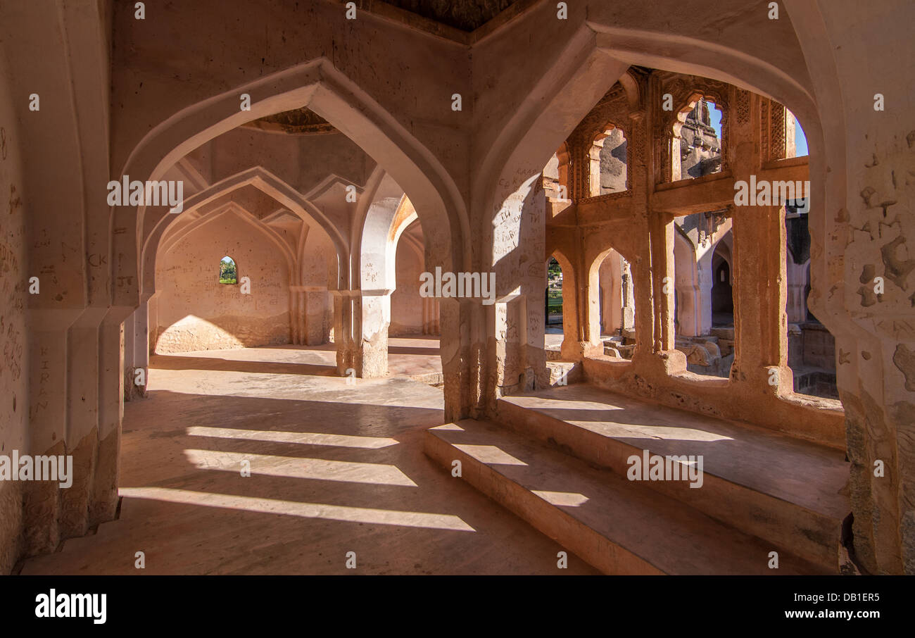 Symmetric arched corridors at Queen's bath, Hampi, Karnataka - Stock Image