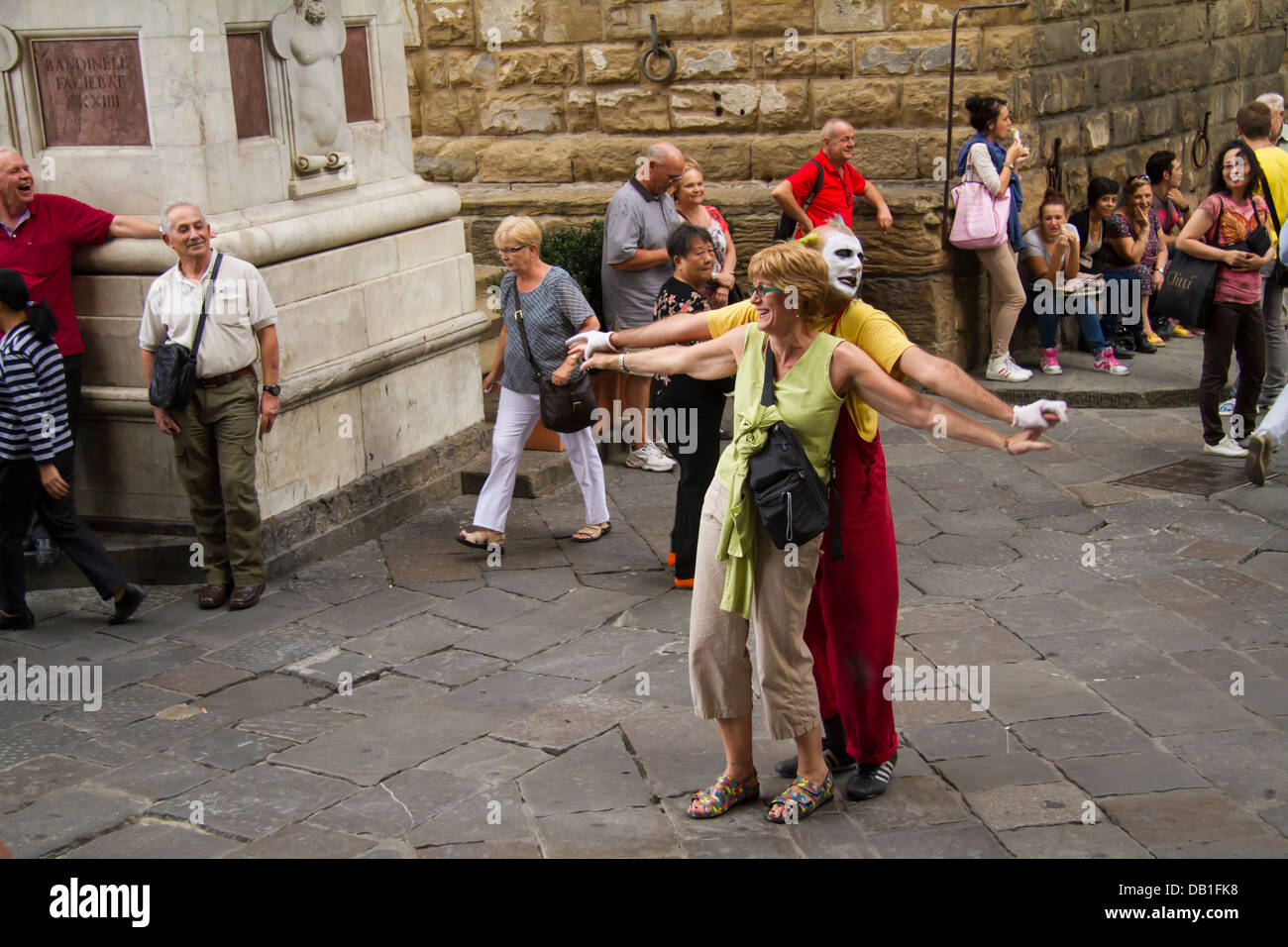 Clown entertaining tourists on the streets of Florence (Firenze), Italy - Stock Image