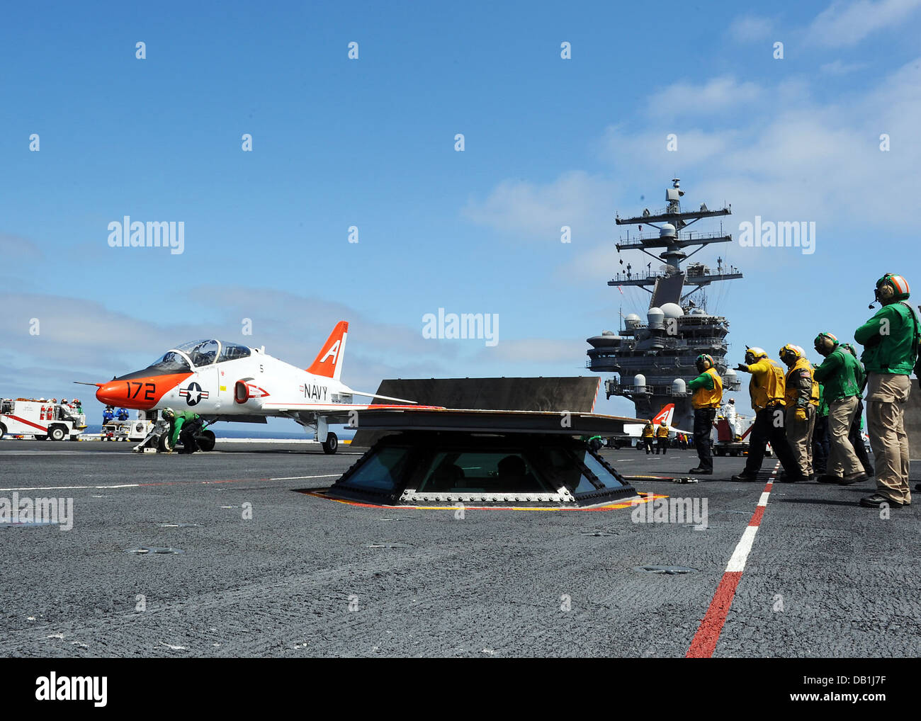 A T-45C Goshawk training aircraft from the Tigers of Training Wing 1 prepares to launch from the flight deck of - Stock Image