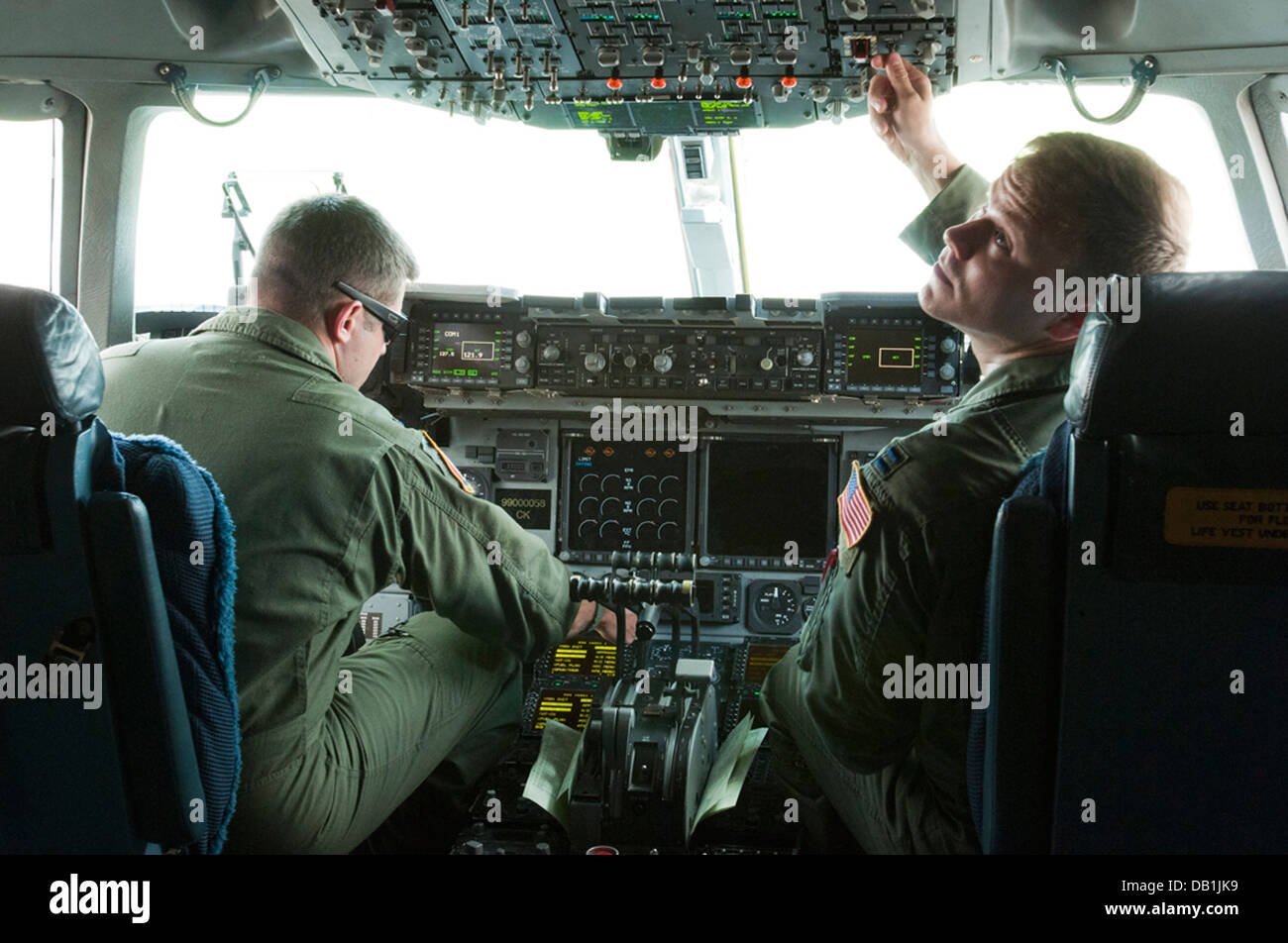 New York Air National Guard Capt. Paul Sloan and 1st Lt. Joshua Early of the 137th Air Lift Squadron, prepare flight - Stock Image