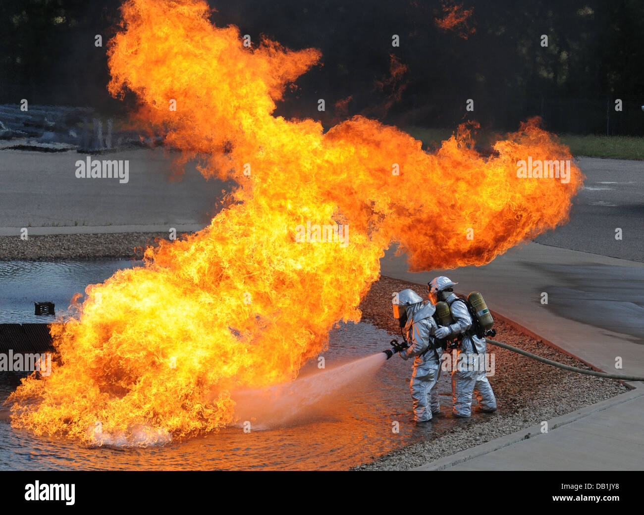 Air National Guard firefighters work to extinguish a plane fire during a training exercise at Volk Field, Wis., - Stock Image