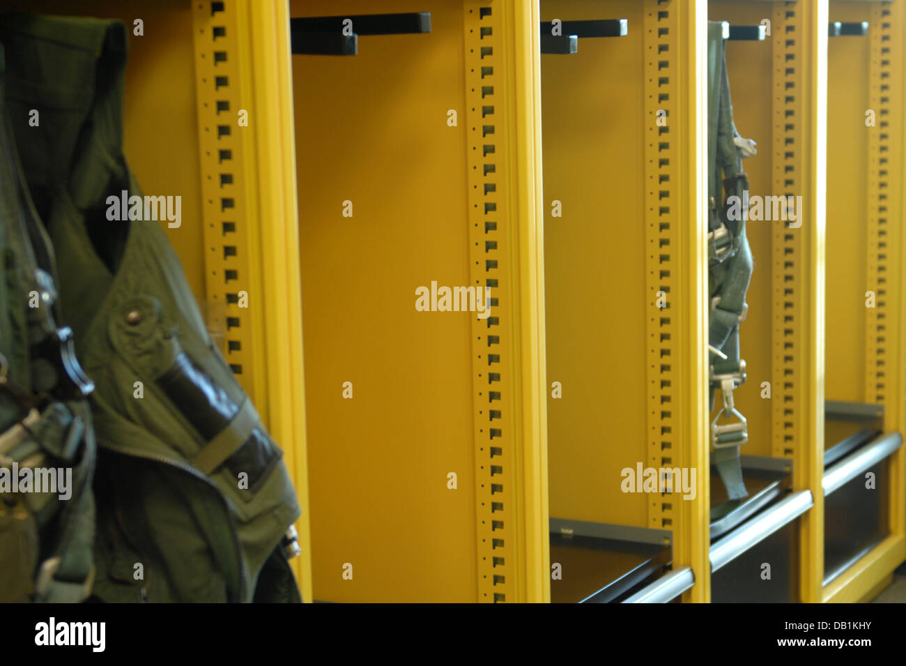 Lockers in the 336th Fighter Squadron's life support room stand empty after pilots geared up for their first - Stock Image