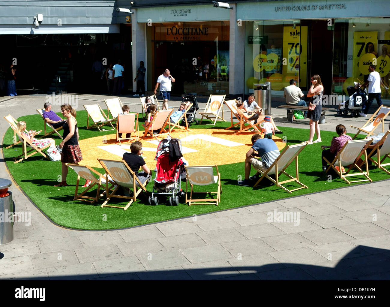 Artificial lawn and deckchairs for hot weather in N1 Centre, Islington, London - Stock Image
