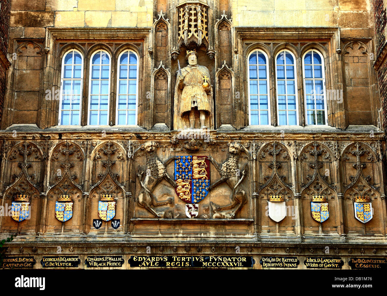 Cambridge, Trinity College gateway, heraldry and statue of King Henry 8th with chair leg, University, England UK - Stock Image