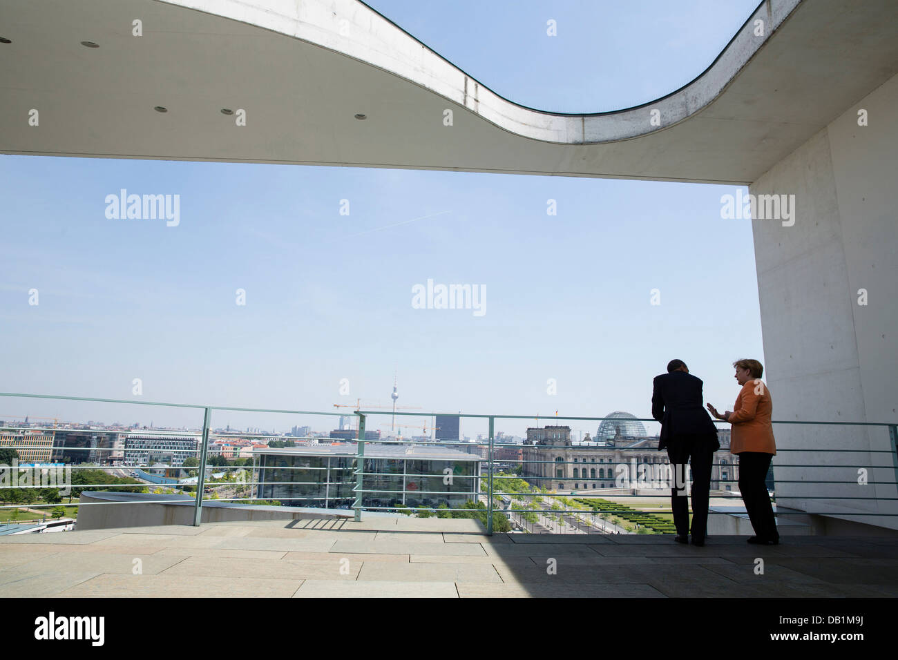 US President Barack Obama and German Chancellor Angela Merkel talk on a balcony of the German Chancellery June 19, - Stock Image