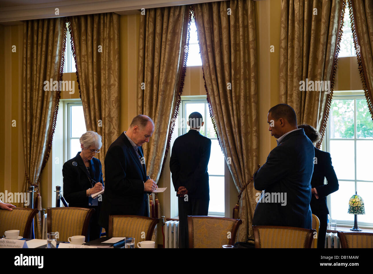 US President Barack Obama waits with advisors before a bilateral meeting during the G8 Summit at the Lough Erne - Stock Image