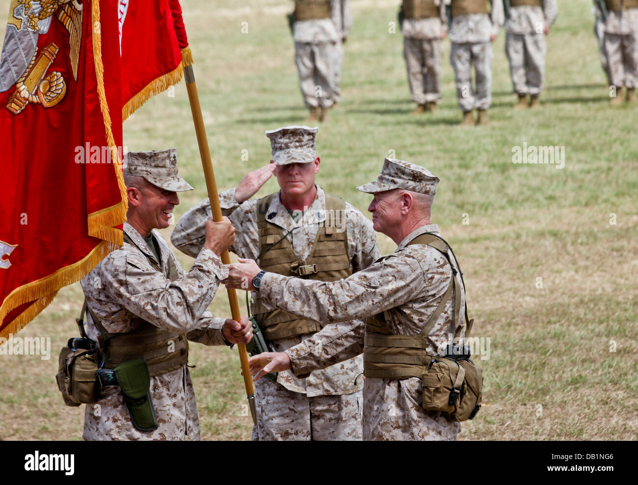 Lt. Gen. Kenneth J. Glueck Jr., right, passes the III Marine Expeditionary Force organizational colors to Lt. Gen. - Stock Image