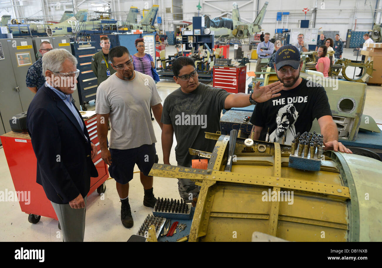 Secretary of Defense Chuck Hagel, left, talks with civilian employees of Fleet Readiness Center Southeast July 16, - Stock Image