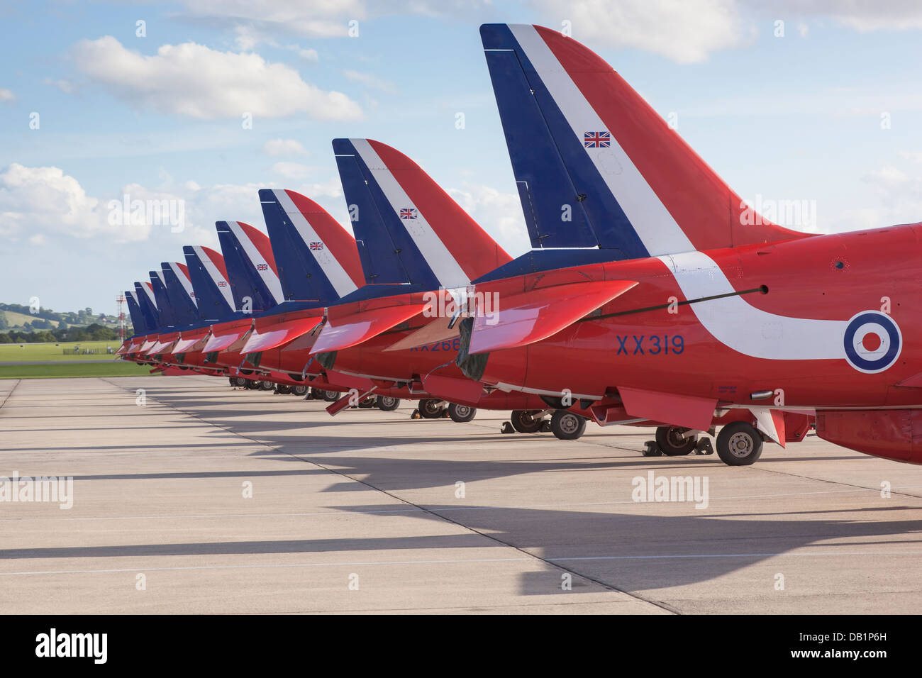The tails of the RAF Red Arrow Hawks on the runway. - Stock Image