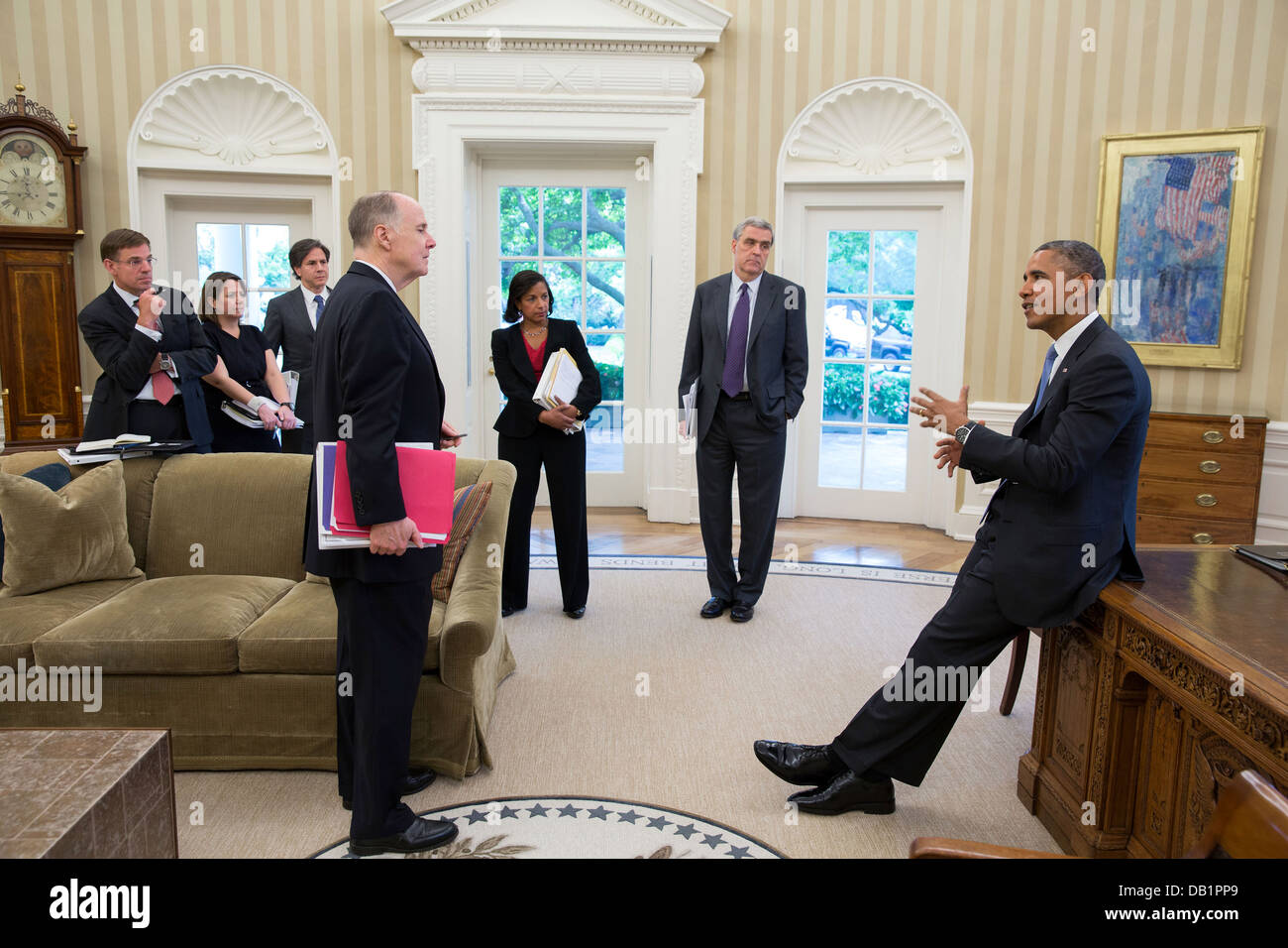 US President Barack Obama talks with advisors in the Oval Office June 25, 2013 in Washington, DC. Pictured, from - Stock Image