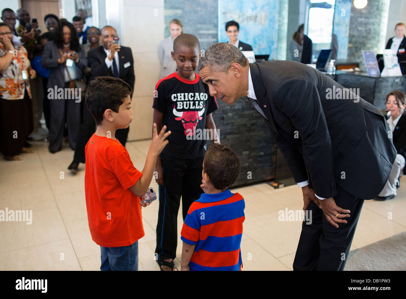 US President Barack Obama talks with young children before departing the Radisson Blu Hotel during his visit June - Stock Image