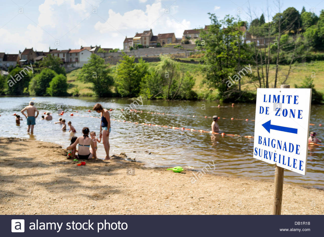 La Celle-Dunoise, Limousin, France. 22nd July, 2013. People cooling off at a beach on the Creuse river to escape - Stock Image