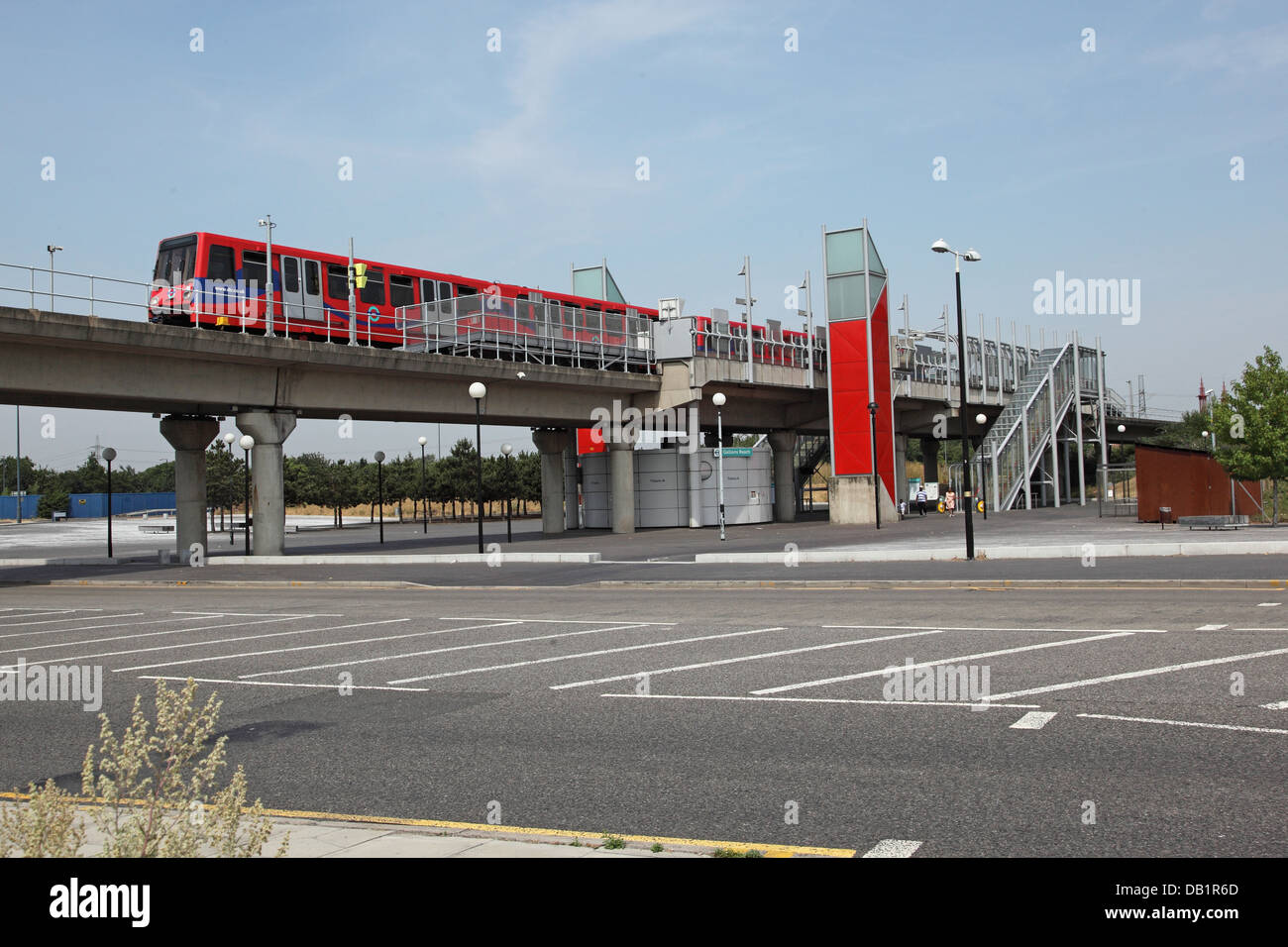 A London Docklands Light Railway train departs from Gallions Reach station in Beckton, east London, UK - Stock Image
