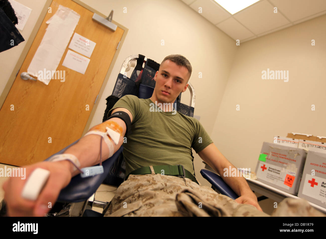 U.S. Marines donate blood at the base chapel aboard Marine Corps Air Station Beaufort, SC, July 17, 2013. The blood - Stock Image