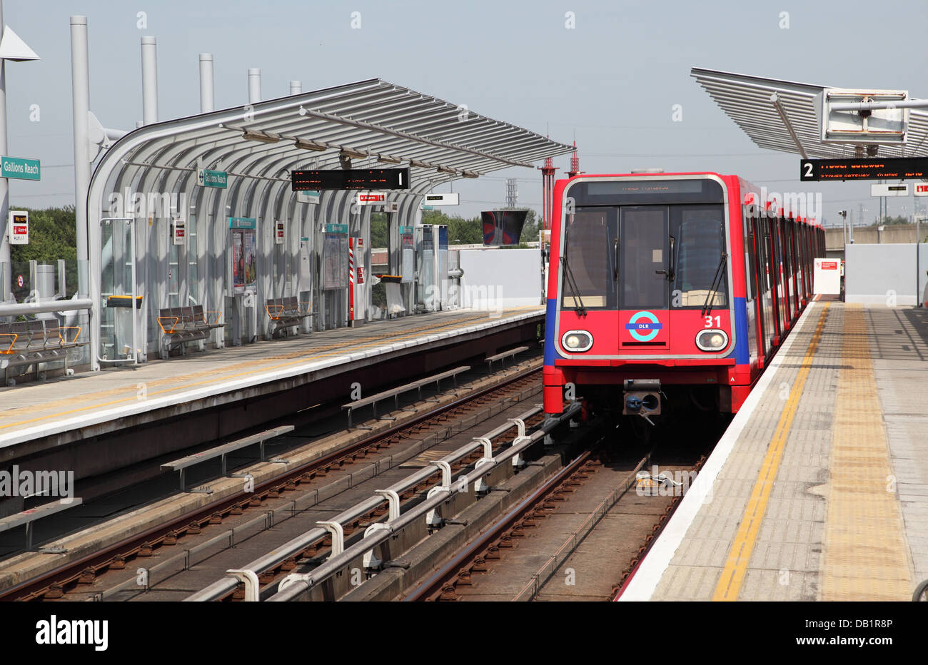 A London Docklands Light Railway train arrives at Gallions Reach station in Beckton, east London, UK - Stock Image