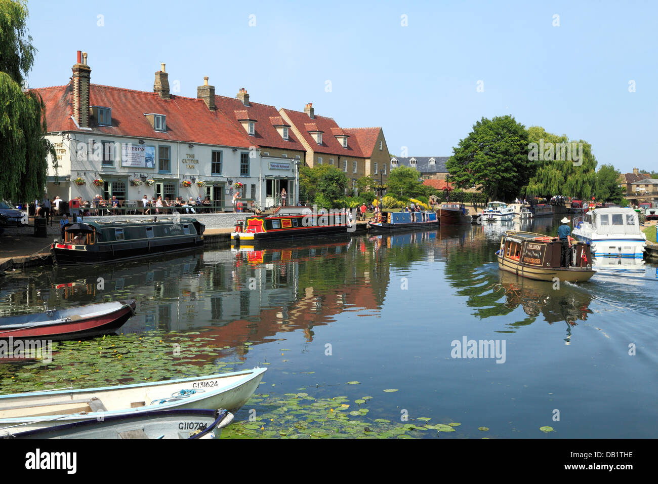 Ely, River Ouse, Cutter Inn, Barges boats English rivers riverside pubs inns pub, Cambridgeshire England UK - Stock Image