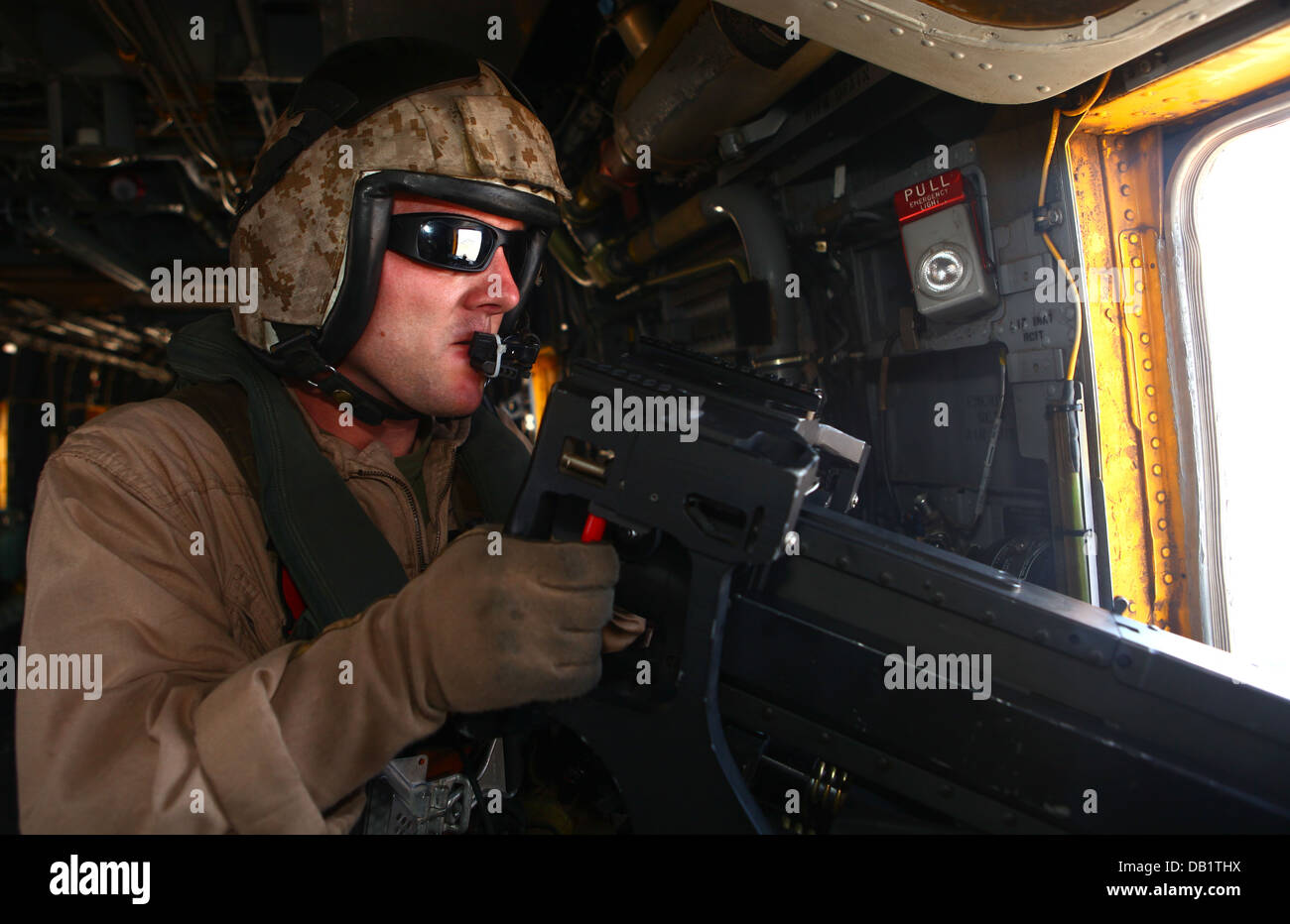 Staff Sgt. Franklin Williams, an aviation ordnance technician with Marine Heavy Helicopter Squadron 465 'Warhorses' - Stock Image