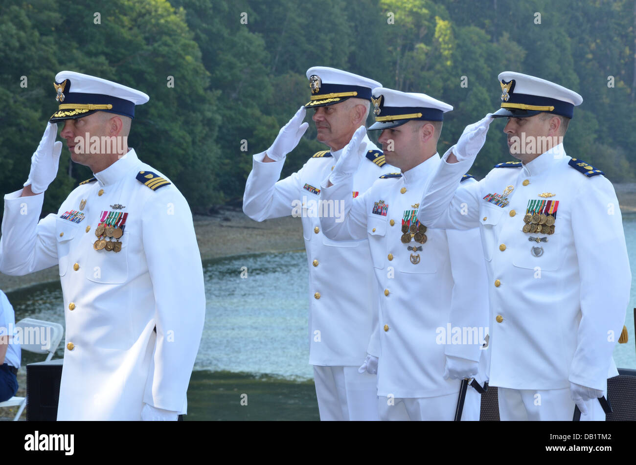Members of a change-of-commande official party for Coast Guard Cutter Sea Fox, an 87-foot patrol boat homeported - Stock Image