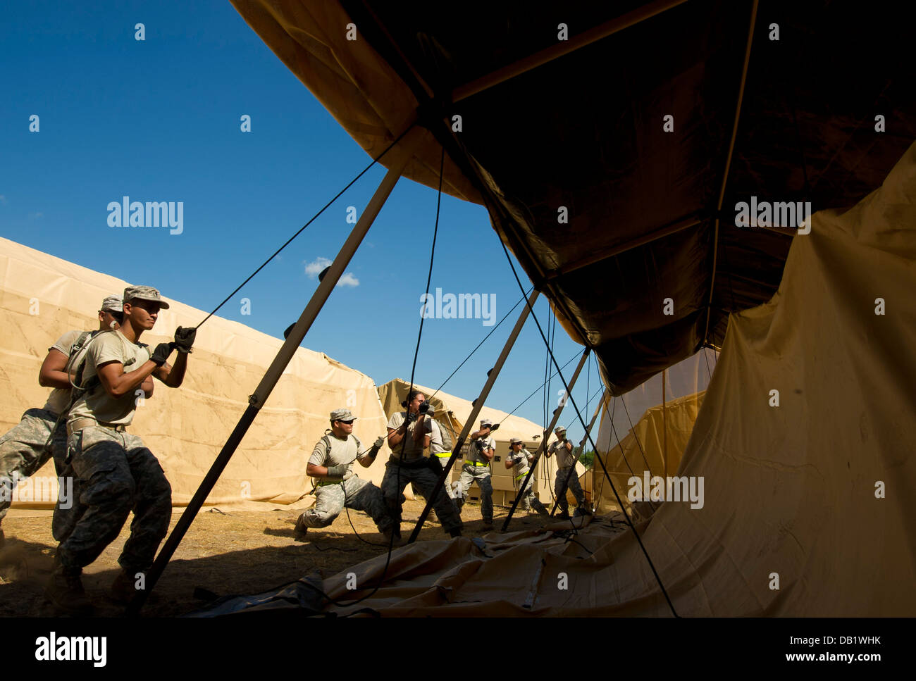 U.S. Air Force and Army personnel assemble a Utilis TM Tall soft shelter during Exercise Global Medic, Fort McCoy, - Stock Image