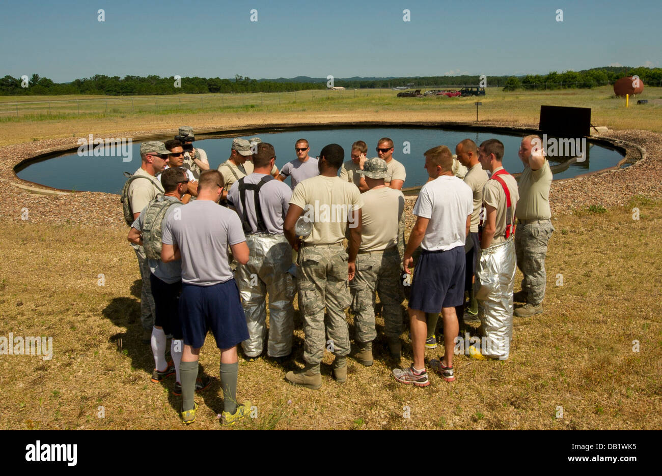 U.S. Air Force firefighters from various bases, are briefed before live-fire training during Exercise Global Medic, - Stock Image