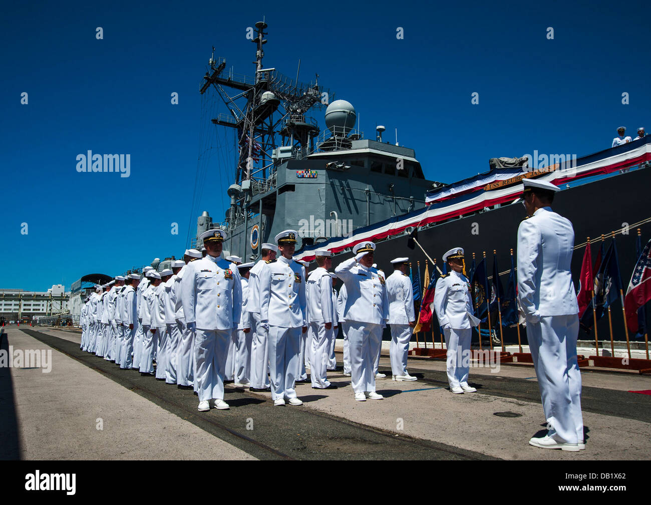 The crew formerly assigned to the guided-missile frigate USS Reuben James (FFG 57) declare the ship as all clear - Stock Image