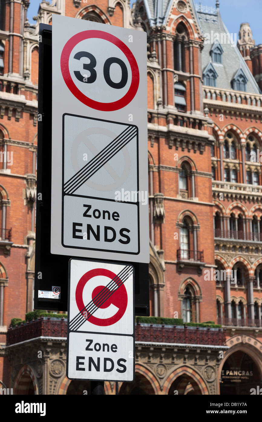 Congestion zone exit sign at Euston Road, St Pancras Station at back, Central London - Stock Image
