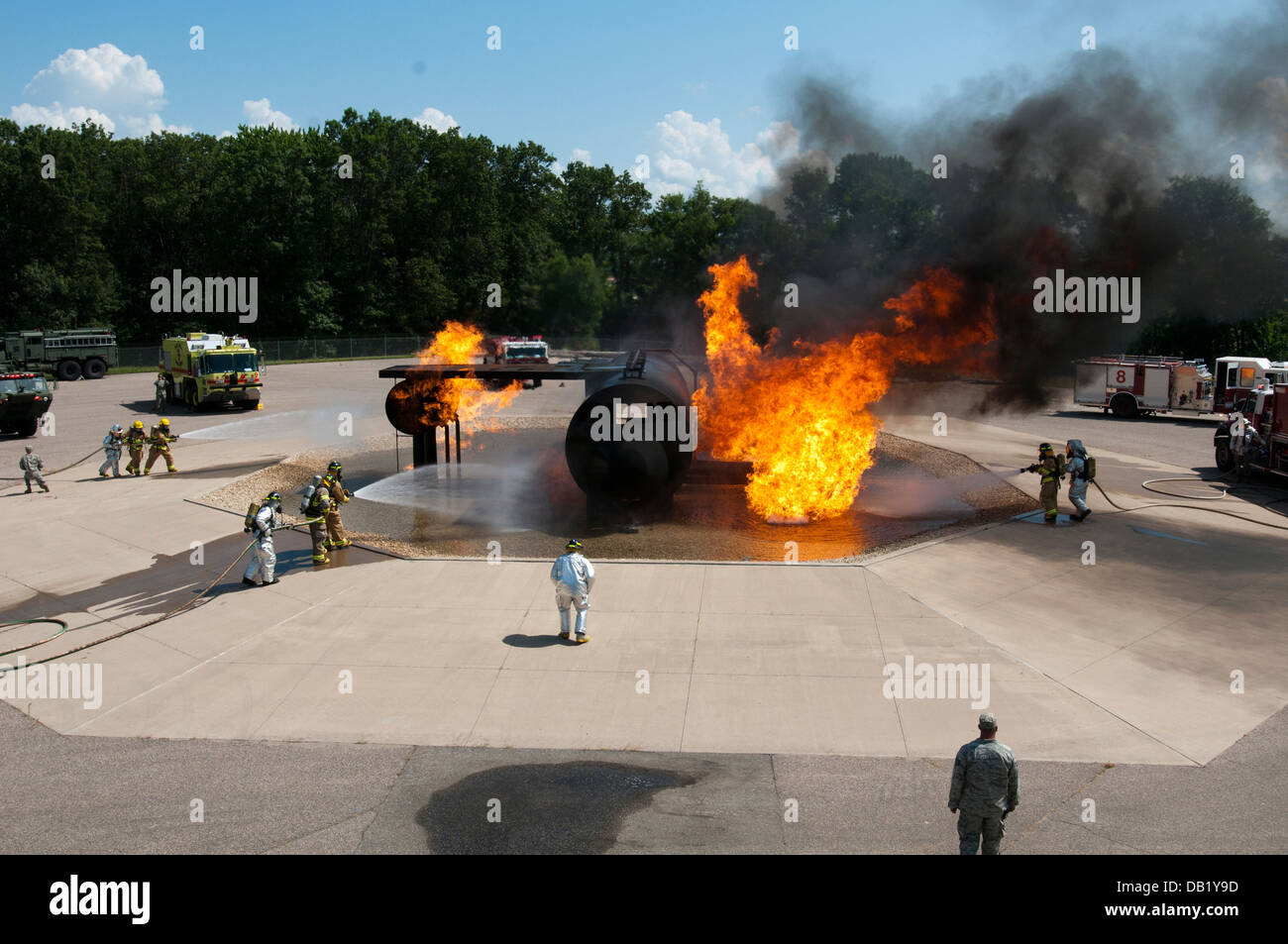 Teams of Air National Guard and U.S. Army Reserve firefighters work to put out a fire at Volk Field Combat Readiness - Stock Image