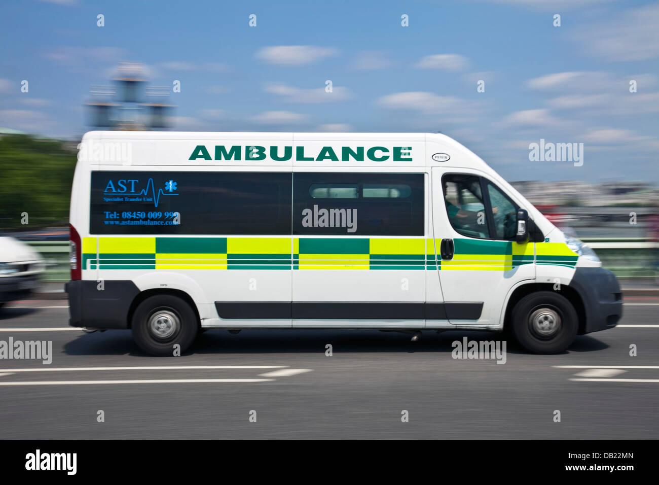 London Ambulance Crossing Westminster Bridge, London, England - Stock Image