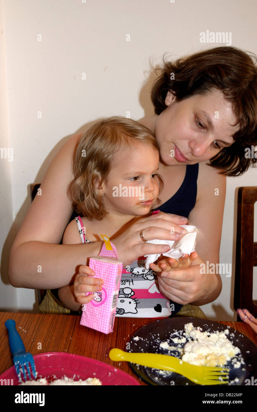 Peachy Litle Girl 2 Year Old With Mother Eating Birthday Cake Stock Photo Funny Birthday Cards Online Eattedamsfinfo