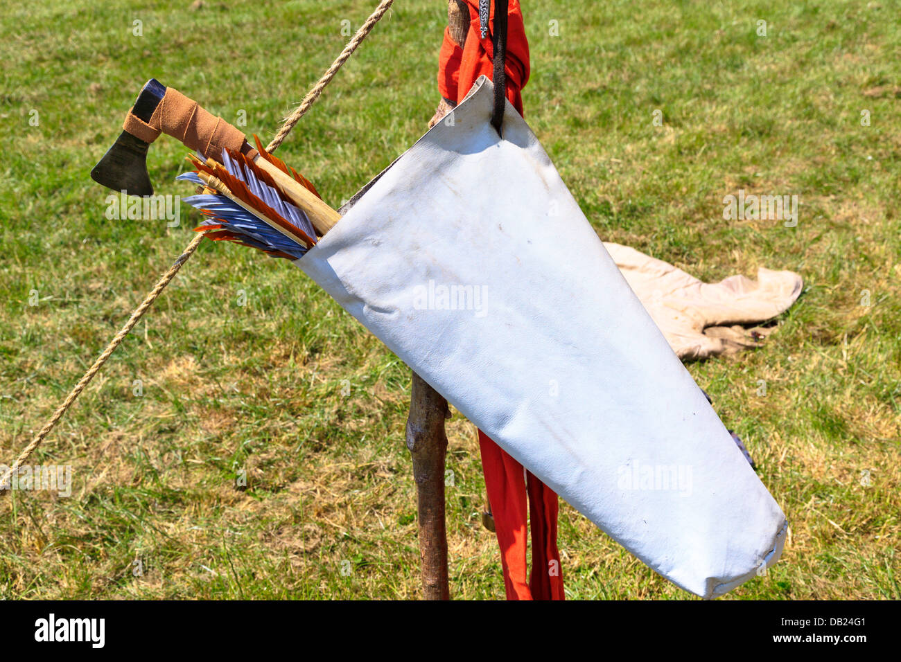 Viking axe and arrows in leather bag for hunting, sports and warfare at Flag Fen Archaeological Park, Peterborough, - Stock Image