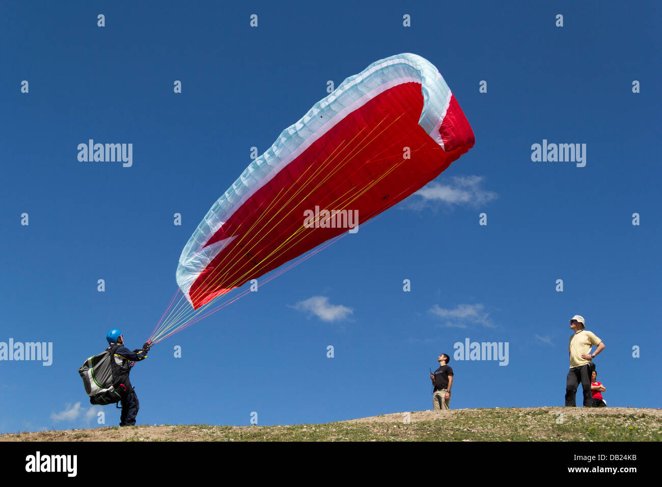 A paraglider pilot performing a reverse launch on take off, Sopot, Bulgaria Stock Photo