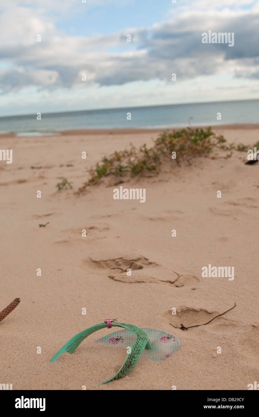 an abandoned thong on christies beach in adelaide, south australia - Stock Image