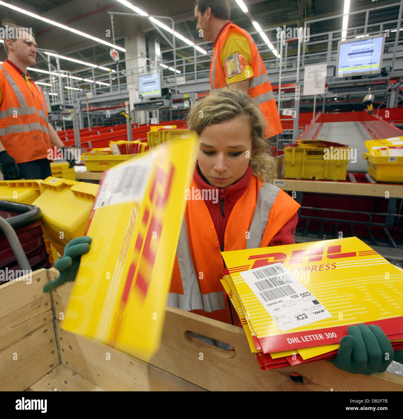 employees of german logistics group dhl sort mail at the dhl hub of stock photo 58448191 alamy. Black Bedroom Furniture Sets. Home Design Ideas