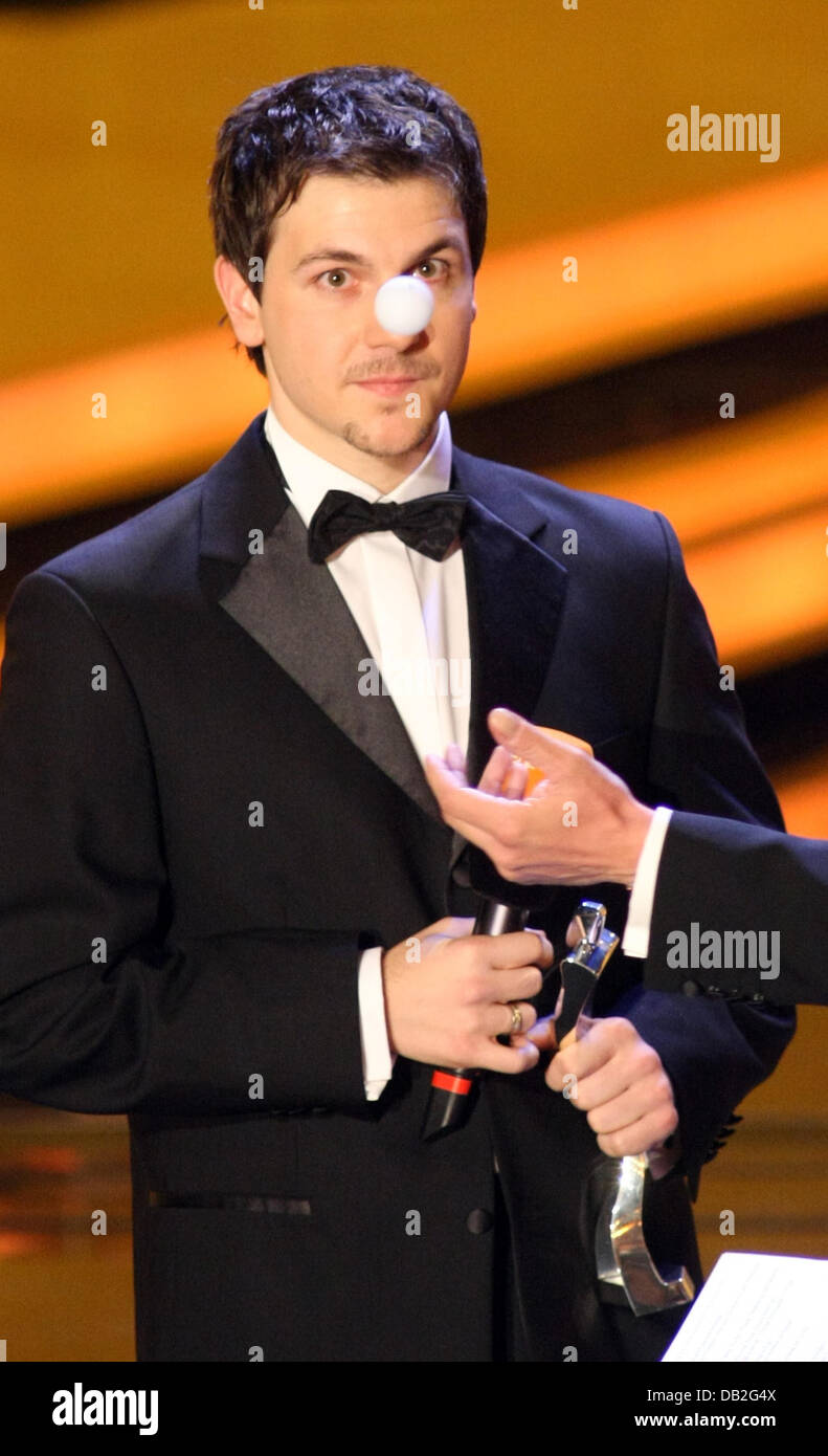 German table tennis player Timo Boll looks at a ping-pong ball during the procalmation of the '2007 Sports Personality' - Stock Image