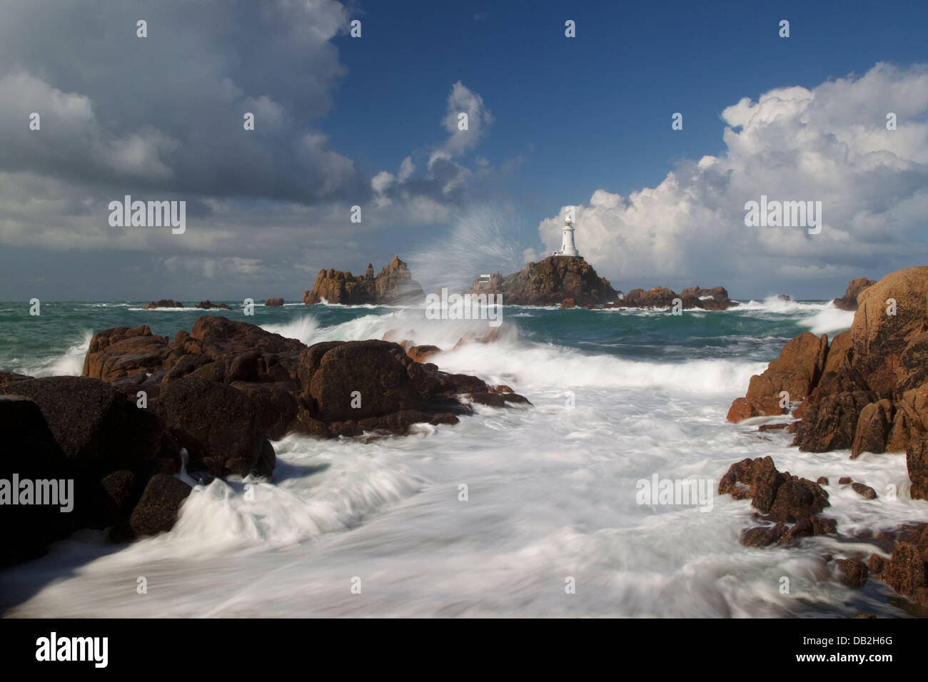 Corbiere Lighthouse - showing tide over causeway Jersey Channel Islands, UK LA005935 - Stock Image