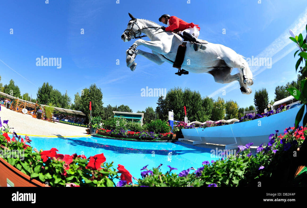 German equestrian Marco Kutscher jumps over a hurdle on his horse Cornet Obolensky during the European Show Jumping Stock Photo